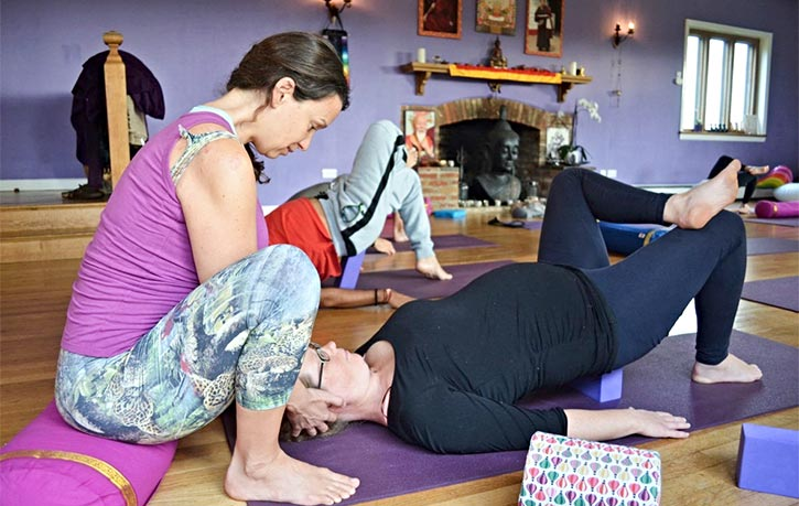Dr Whitehouse assists during a yoga class