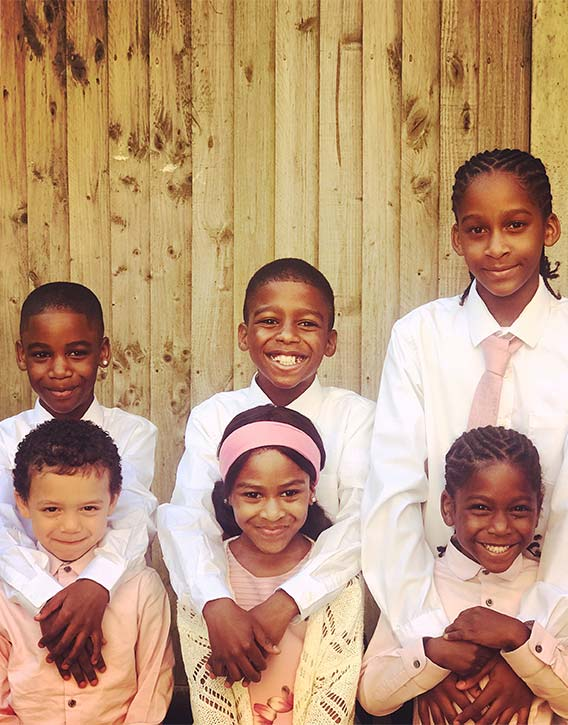 Omari with his brothers and sister