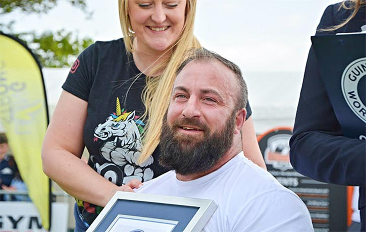 Martin with partner Beckie receives his Guiness World Record certificate
